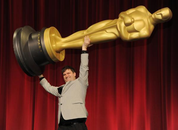 "Filmmaker John Mattiuzzi of the School of Visual Arts in New York, a nominee in the Alternative Category for his film ""The Compositor,"" hoists up an Oscar statue for photographers before the Academy of Motion Picture Arts and Sciences 40th Student Academy Awards at the Samuel Goldwyn Theater."