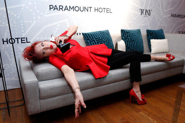 """Cyndi Lauper reclines with her Tony for score, which she won for her work on """"Kinky Boots,"""" in the Paramount Hotel Winners' Room at Radio City Music Hall on Sunday night."""