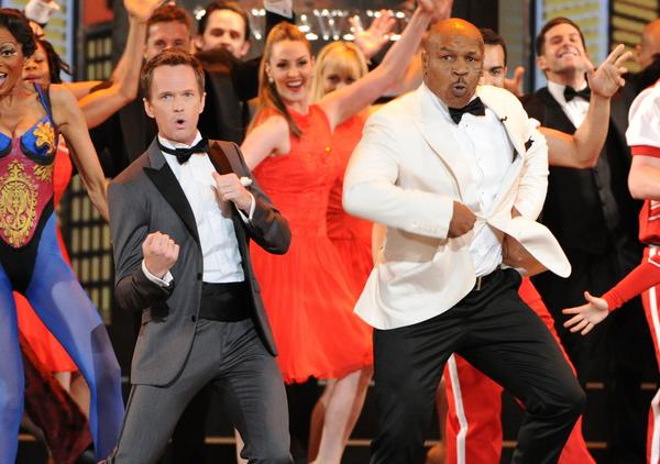 Host Neil Patrick Harris and casts of Broadway shows perform during the big opening number.