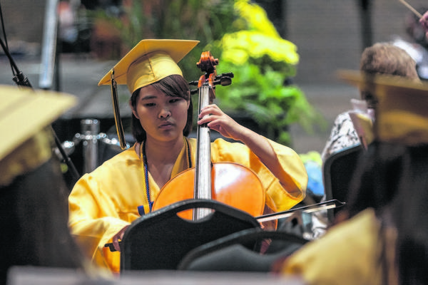 "Cellist Eunah Jang, a Korean exchange student, helps perform ""Selections from 'Les Mise'rables'"" during the Riley High School graduation ceremony at Century Center in South Bend, on Sunday, June 9, 2013."