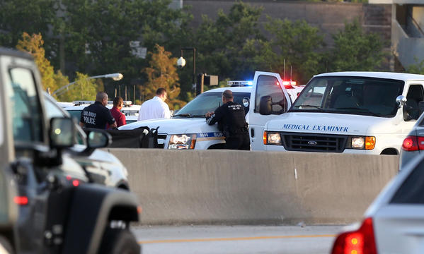 Commuters found serious delays on westbound Interstate 4 early Monday, June 10, 2013, after an Orlando Police Department officer was involved in the fatal shooting of an armed man who was standing on the road (Red Huber/Orlando Sentinel).