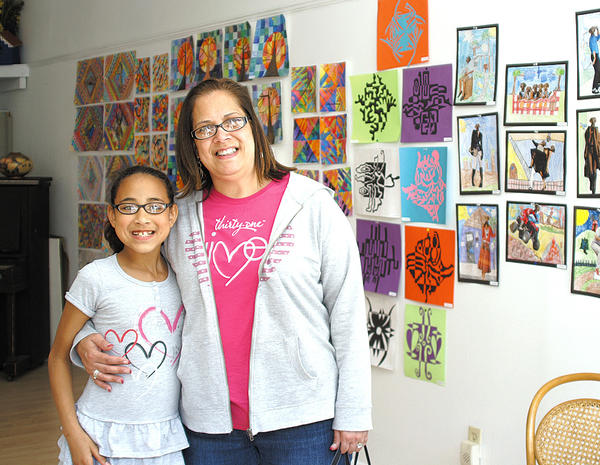 Works of art by 125 students from St. Mary Catholic School students are on display at Contemporary School of the Arts and Gallery in downtown Hagerstown. Art teacher Marisa Kenny and her daughter are shown with some of the works.
