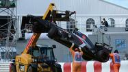 A track marshal died Sunday from injuries sustained when a crane backed over him while he was tending to Esteban Gutierrez's crashed car in the Formula 1 Canadian Grand Prix in Montreal.