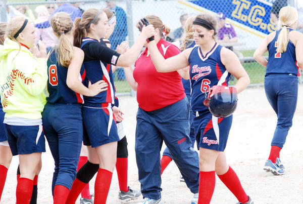 Boyne City senior shortstop Jessica Selissen (right) is congratulated by teammate Rainy McCune moments following the Ramblers 8-2 loss to Gladstone Saturday in a Division III regional semifinal in Traverse City.
