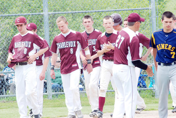 Members of the Charlevoix High School varsity baseball team including (from left) Shane Sutherland, Luke Klinger, Will Telgenhof and Tag McCreadie walk off the field moments following the Rayders 2-1 loss to Negaunee Saturday in a Division III regional semifinal in Traverse City. The Rayders finished the season with a 27-3 record.