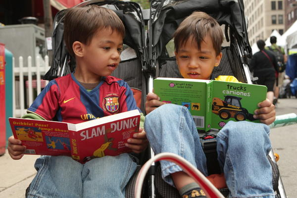Twins Frederick, left, and Martin Krug, 3 (cq) of Chicago bought eight books to share Sunday morning June 7, 2009 at the 25th Annual Chicago Tribune Printers Row Lit Fest. (Nancy Stone/ Chicago Tribune) ..OUTSIDE TRIBUNE CO.- NO MAGS, NO SALES, NO INTERNET, NO TV, CHICAGO OUT.. 00307534B LIT FEST
