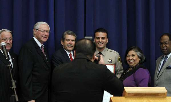 L.A. County Supervisors Don Knabe, left, Michael D. Antonovich and Zev Yaroslavsky, Sheriff's Reserve Deputy Shervin Lalezary, and county Supervisors Gloria Molina and Mark Ridley-Thomas.
