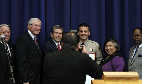 L.A. County Supervisors Don Knabe, left, Michael D. Antonovich and Zev Yaroslavsky, Sheriff's Reserve Deputy Shervin Lalezary, and county Supervisors Gloria Molina and Mark Ridley-Thomas.