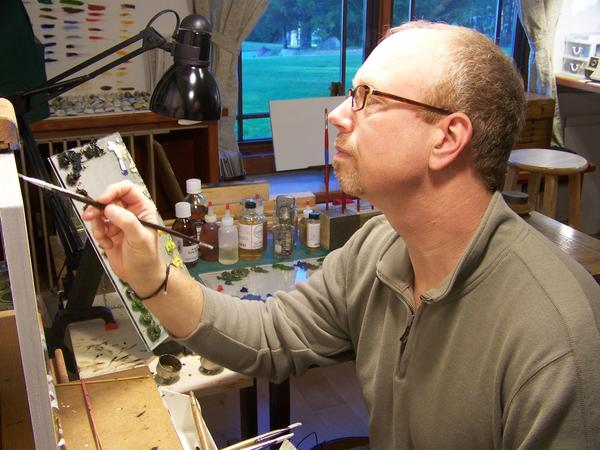 Caesar Citraro works on a painting in his studio. The artist will lead an introduction to plein air painting class June 14-15 at the Crooked Tree Arts Center in Petoskey.