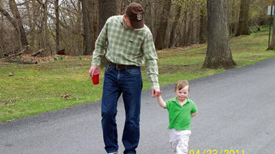 Shawn Dorian, father of 10, takes a walk with his youngest child, 4-year-old Danny.
