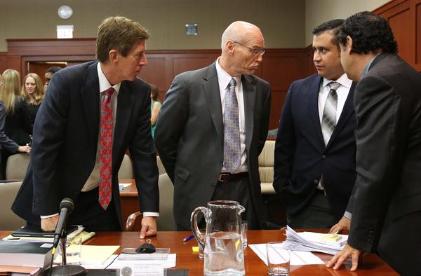 George Zimmerman and his attorneys discuss jury questionnaires in Seminole circuit court, with defense attorney Mark O'Mara (left) co-counsel Don West (center), and jury consultant Robert Hirschhorn (far right), on the first day of his trial, in Sanford, Fla., Monday, June 10, 2013. Zimmerman is accused in the fatal shooting of Trayvon Martin. (Joe Burbank/Orlando Sentinel) newsgate CCI B582971927Z.1