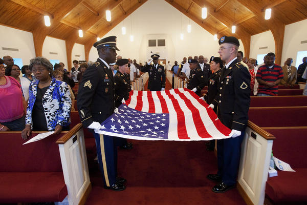 The flag detail from Joint Base Langley-Eustis presents a flag before folding it during a dedication ceremony for a memorial sign at First Baptist Church Denbigh on Saturday, June 8.