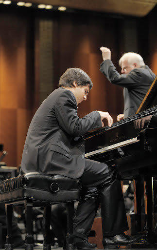 Vadym Kholodenko of the Ukraine in his winning performance in the Van Cliburm International Piano Competition. Leonard Slatkin conducts.