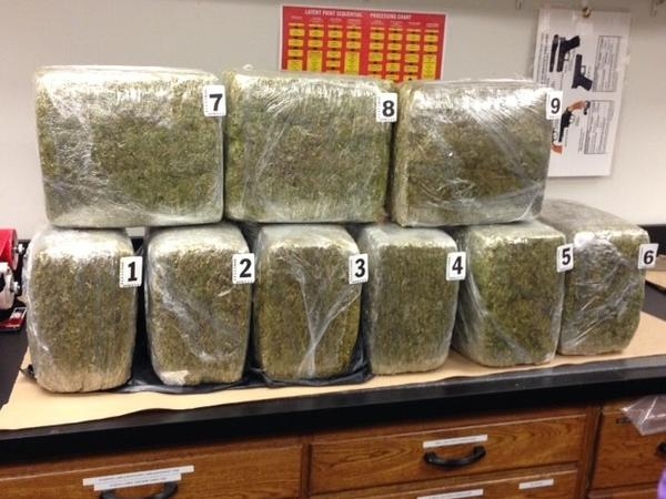 Evanston police officers found 100 pounds of marijuana in a recycling container.