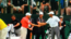 Weeks of snippy comments between Tiger Woods and Sergio Garcia gave way to a simple handshake at the driving range Monday.