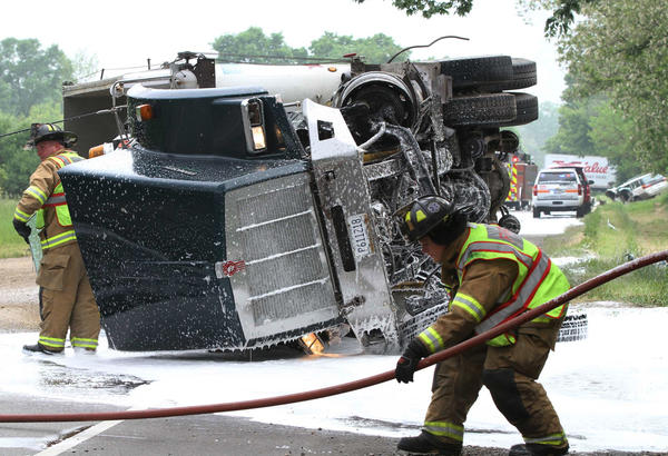 Firefighters work at the scene of a crash between a semi and a car in the 27000 block of Route 173 in Antioch.