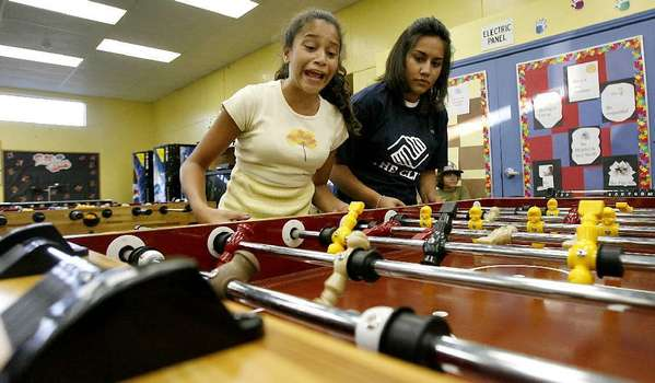 Teens play foosball at the Boys & Girls Club in Burbank in this file photo.