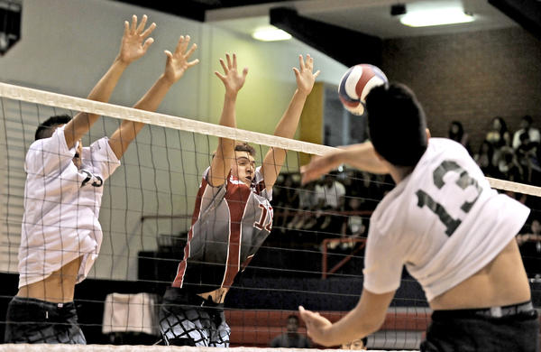 Gabrielino's Calvin Chen (25), left, and John Burroughs' Nick Van Loo (18), center, go up for the block as Damien's Chris Mercado (13), right, hits the ball over the net during the 2013 San Gabriel Valley Public vs. Private All-Star Underclassmen Boys' Volleyball match at La Salle High School on Sunday, June 9, 2013.