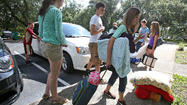 The luggage kept cascading out the back of the two Dodge Grand Caravans as 10 teenagers from Orlando's University Unitarian Universalist Society prepared Monday for a five-day tour of civil-rights memorials and museums.
