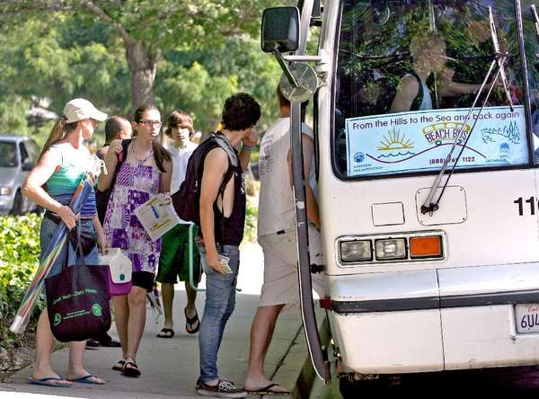 A Los Angeles County bus that transports residents in La Canada Flintridge, Montrose and La Crescenta to Santa Monica returns on June 18. Above, local teens take the bus in 2010.