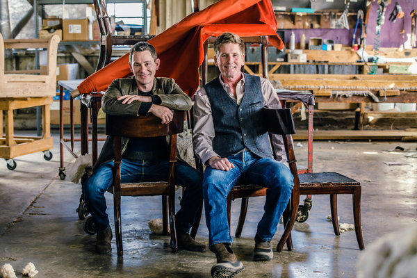 Interior designers Lawrence Lazzaro, left, and Nicholas Hertneck have opened Nicholas Lawrence Interior Design Studio and Fine Home Furnishings in the heart of Brentwood Village this month. Here they are pictured at the Los Angeles manufacturer that produces their collection.