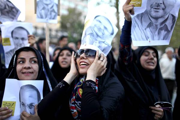 Supporters rally for Iranian presidential candidate Mohammed Baqer Qalibaf, Tehran's mayor, in the capital. Qalibaf and nuclear negotiator Saeed Jalili are seen as the front-runners in the race.