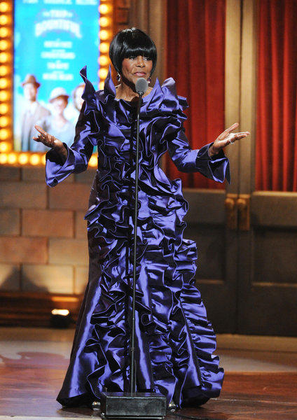"Cicely Tyson wears a gown by B. Michael America Couture as she accepts the award for best performance by a leading actress in a play for her role in ""The Trip to Bountiful,"" at the 67th annual Tony Awards on Sunday."