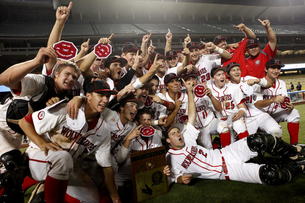 Harvard-Westlake celebrates their victory in the Southern Section Division 1 championship game at Dodger Stadium.