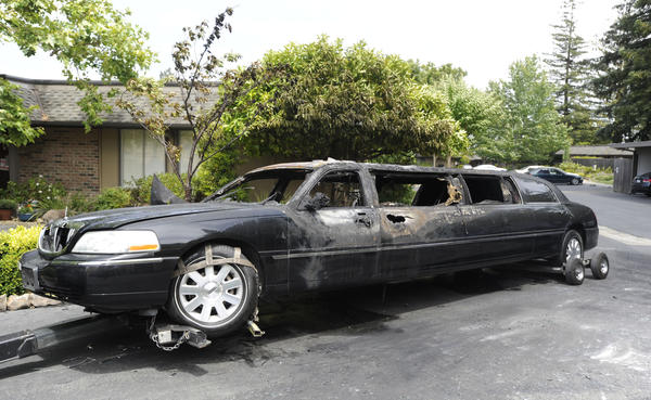 A burned-out 2009 Lincoln Town Car limousine sits in a driveway along Skycrest Drive in the Rossmoor community of Walnut Creek. Ten women heading to a birthday party escaped unharmed when the limousine burst into flames.