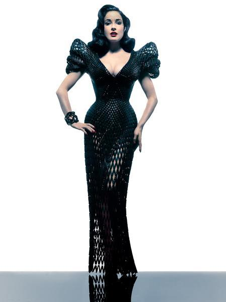 A 3-D printed gown created by designer Michael Schmidt in collaboration with online 3-D printing marketplace Shapeways and architect Francis Bitonti, and modeled by burlesque star Dita Von Teese.