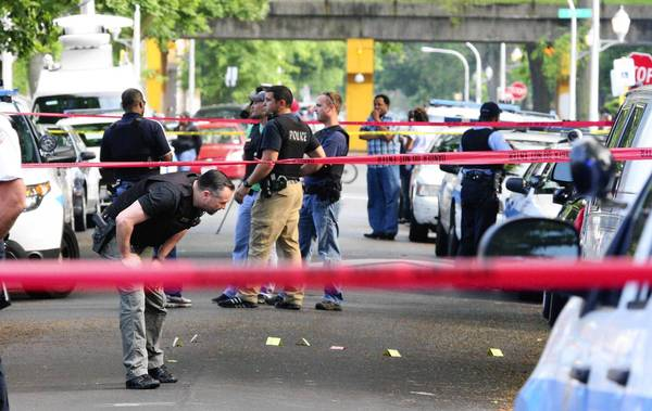 Chicago police dept investigate multiple shootings at 57th South Sangamon Street.