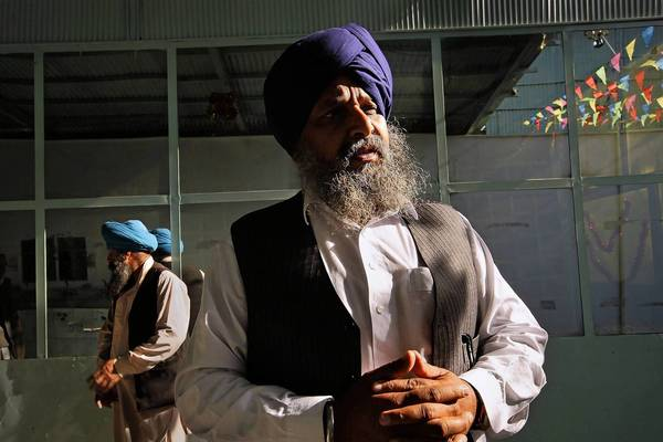 Decades of war, instability and intolerance in Afghanistan have fueled waves of Sikh emigration, reducing the community to just 372 families nationwide, says Awtar Singh Khalsa, right, association president of the Karte Parwan temple in Kabul.