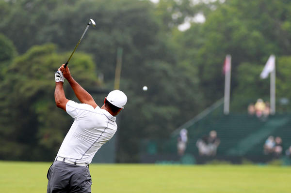 Tiger Woods hits a shot during a practice round at Merion Golf Club.