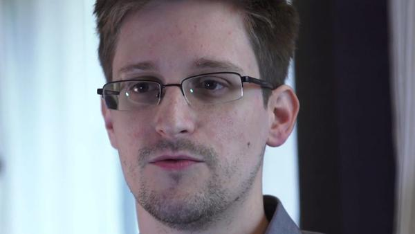 A video still courtesy of The Guardian newspaper shows former CIA employee Edward Snowden during an exclusive interview with the newspaper's Glenn Greenwald and Laura Poitras in Hong Kong. During the interview he revealed himself as the source of documents outlining a massive effort by the U.S. national security agency to track cell phone calls and monitor the e-mail and internet traffic of virtually all Americans.