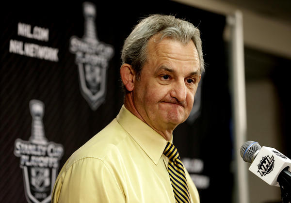 Kings head coach Darryl Sutter talks to reporters after the Chicago Blackhawks' 4-3 win over the Kings.