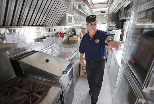 Brian Johnson, resource manager with the Aberdeen Salvation Army, points out one of the refridgeration units in the canteen truck Tuesday. The canteen truck is used for emergencies and disasters to provide help for vicitims and emergency responders. photo by john davis taken 6/4/2013