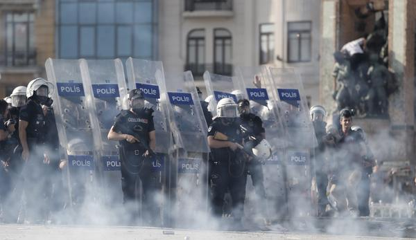 Police use tear gas and water cannons to disperse protesters during a clash at Taksim Square in Istanbul, Turkey.