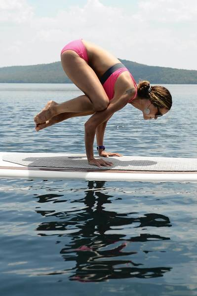 Laurel Attanasio, a paddleboard and yoga instructor from Bethlehm, practices yoga on her board on Round Valley Reservoir in Lebanon, N.J.