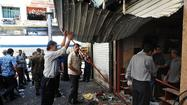 BEIRUT -- A twin suicide bombing targeted a square in central Damascus on Tuesday morning, killing at least 14 people and injuring more than 30 others, Syrian state media reported.