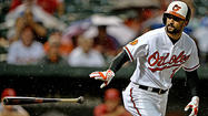 Orioles overcome a two-hour rain delay to beat the Angels 4-3