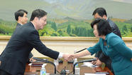 SEOUL (Reuters) - Planned high-level talks between South and North Korean after a six-year hiatus and threats of war were scrapped on Tuesday, South Korean government officials said, over a seemingly minor disagreement over the diplomatic ranks of chief delegates.