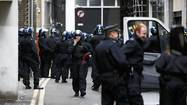 LONDON (Reuters) - British riot police clashed with anti-capitalist protesters in running confrontations through the streets of central London on Tuesday, arresting at least 32 people as activists targeted some of the world's biggest companies before next week's G8 summit.