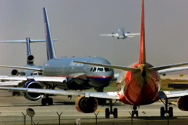 Planes line up for takeoff at Los Angeles International Airport.