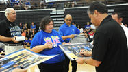 She was holding two basketballs, two camp T-shirts and two backpacks, but Harrodsburg's Christie McGlone wasn't going to miss a chance to take a picture of her two sons with Kentucky basketball senior Jarrod Polson — or any UK coach or player at Monday's John Calipari Satellite Camp at Boyle County High School.