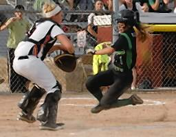 Angela Scalzitti #1 of York scores, getting past the tag of Kelsey Smith of Minooka in the Illinois High School Association Class 4A Softball semifinal game between York and Minooka. Minooka beat York 6 to 3