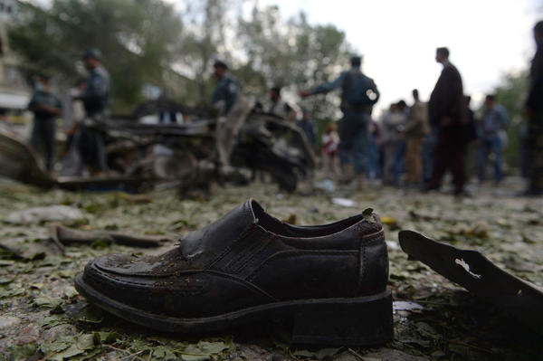 A victim's shoe lies on the ground as Afghan police secure the site of a suicide attack in Kabul on Tuesday.