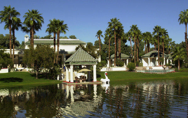 The main house, left, and two guest houses at Merv Griffin's former desert retreat can be seen across a lagoon.