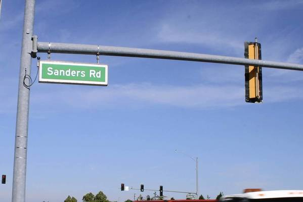Sanders Road, seen on the photo of a street sign in the Village of Northbrook, morphs into Saunders Road once it crosses Lake Cook Road. The road is spelled Sanders in Cook County but changes to Saunders in Lake County. The different spellings have been in place for many decades.