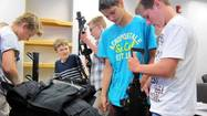 During the first day of the new St. Charles Youth Police Academy, about 20 teenagers eagerly tried on a SWAT team vest and handled real guns — not loaded, of course — used by police officers.