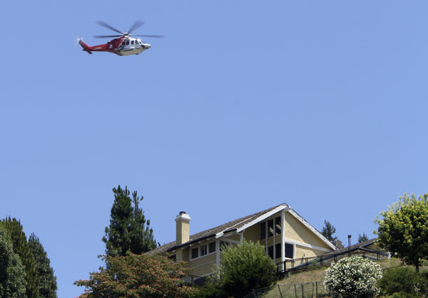A helicopter flies near the 405 Freeway during the weekend-long road closure in 2011 known as Carmageddon, when helicopters carrying media, tourists and other curiosity seekers hovered for hours over the site.